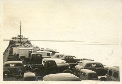 The LEONARD B. MILLER in the ice with a deck load of vehicles