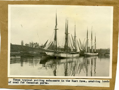 These typical sailing schooner in the East Cove awaiting loads of coal for Canadian ports
