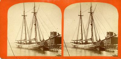 Two-masted sailing vessel at dock