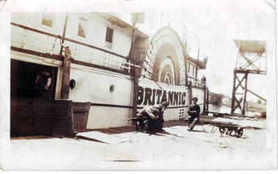 Raoul Lalonde and crew on dock next to Britannic