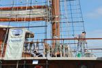 Swabbing the decks - tallship Peacemaker