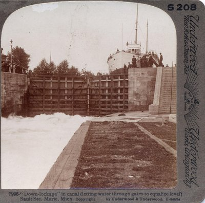 """Down-lockage"" in canal (letting water through gates to equalize level) Sault Ste. Marie, Mich."