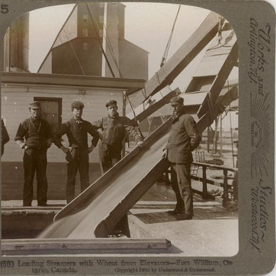 Loading Steamers with Wheat from Elevators -- Fort William, Ontario, Canada
