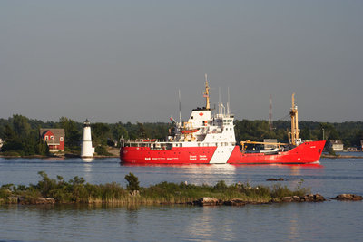 CCGS GRIFFON passing Rock Island Light house