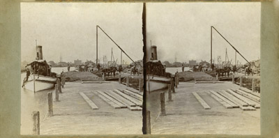 H. C. CURTIS and barge in a canal