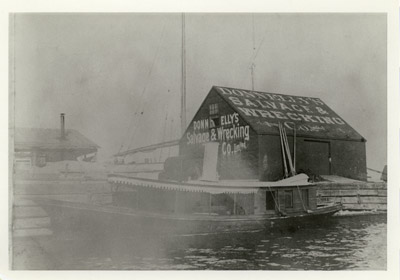 Donnelly's Salvage & Wrecking Co. shed and steam yacht