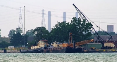 U.S. Army Corps of Engineers tugboat DEMOLEN with dredge and barge