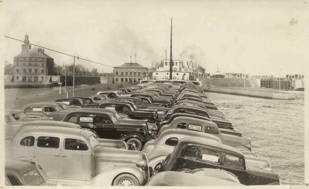 The LEONARD B. MILLER at the Sault with a deck load of 1936 Plymouths