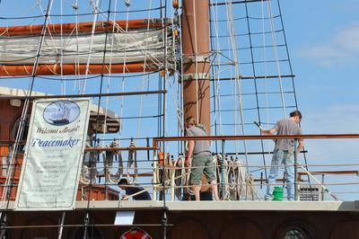 Swabbing the decks - tallship Peacemaker