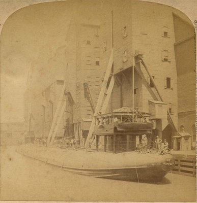 Loading the Great Whaleback Ship at the Famous Grain Elevators, Chicago