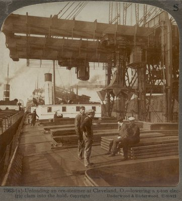 Unloading an ore-steamer at Cleveland, O. -- lowering a 5-ton electric clam into the hold