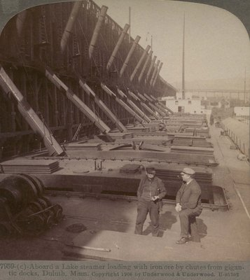 Aboard a Lake steamer loading with iron ore by chutes from gigantic docks, Duluth, Minn.