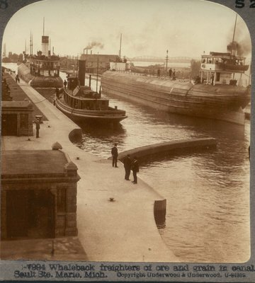 Whaleback freighters of ore and grain in canal, Sault Ste. Marie, Mich.