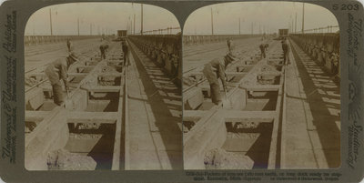 Pockets of iron ore (160 tons each) on long dock ready for shipment, Escanaba, Mich.