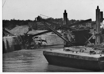 Dredge destroying old aqueduct on Welland Canal