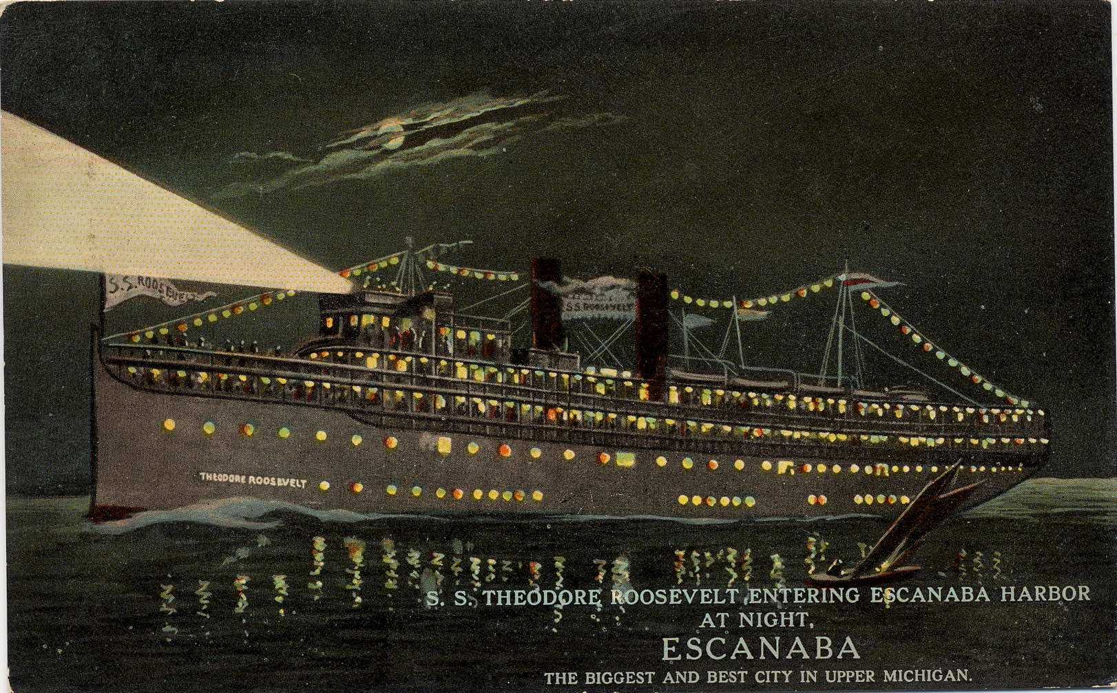 S. S. Theodore Roosevelt entering Escanaba Harbor at night.